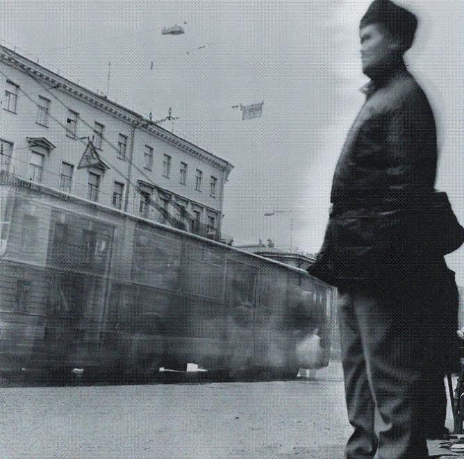 Pensioner at a trolley bus stop, 1992, St. Petersburg | Courtesy of Alexey Titarenko