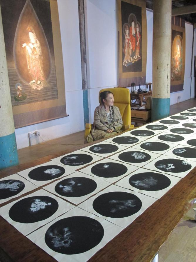 Bingyi Huang with her works