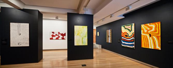 Installation view of Traversing Borders: Art from the Kimberley 2014, QUT | © Richard Stringer