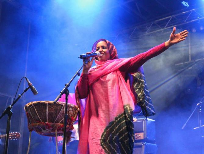 Aziza Brahim performing on stage
