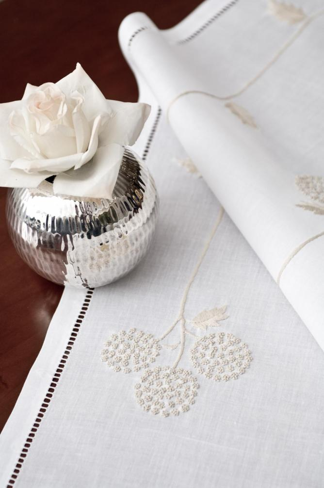 Embrodery on table cloth - Tan My Design
