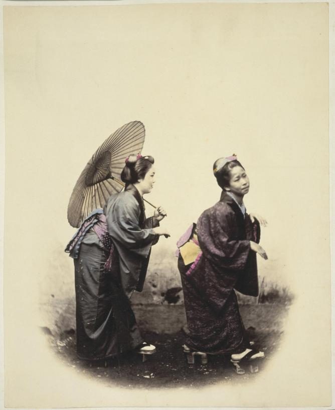 "Two women with a parasol, in traditional costume and footwear, Japan, taken between 1867 and 1869. The original caption reads ""The original Grecian Bend"". © National  Library NZ/ Flickr"