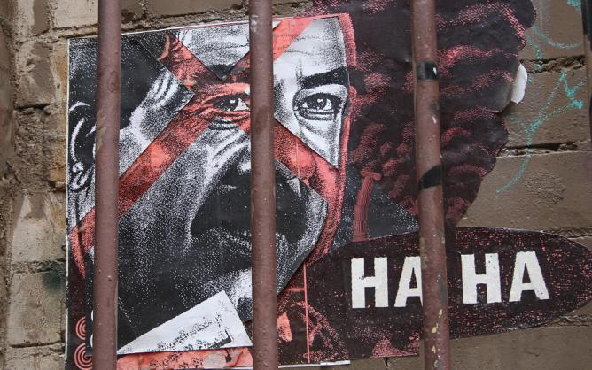 """Artist Haha (Regan Tamanui) imprisons Saddam Hussein"" | © Nagarjun Kandukuru/Flickr"