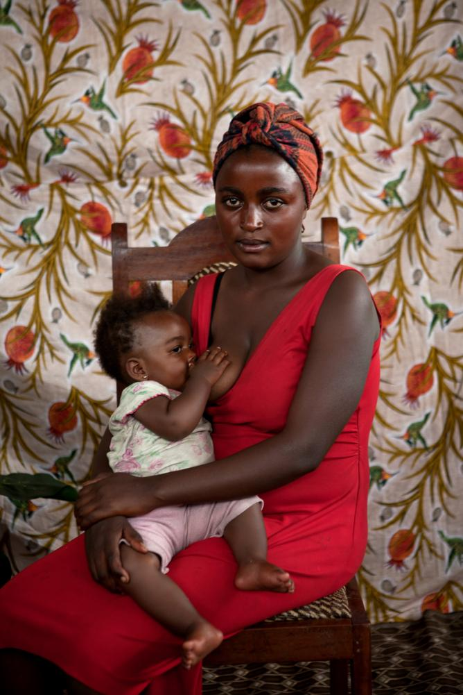 Alexia Webster, 'Refugee Street Studio', 2014-ongoing, Bulengo IDP Camp- Goma, DR Congo 23 year old Masika Chanse from Sake with her baby Mary, 10 months old | Courtesy the artist