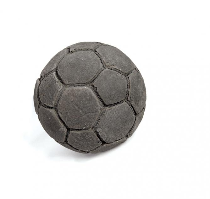 Khaled Jarrar. 'Football', 2012,Cement Sculpture, 23 cm. diameter, edition of 7 | Courtesy the artist and Ayyam Gallery