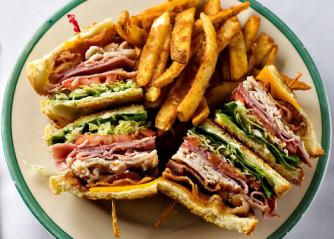 Club sandwich with side of fries | Courtesy of Gardner Village