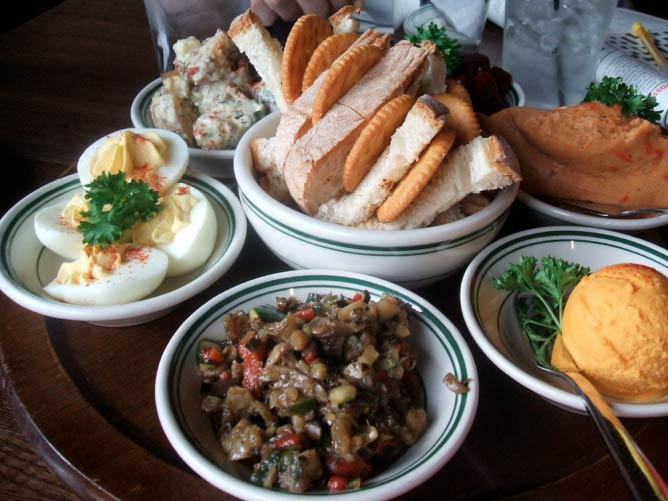 Appetizer spread on a Lazy Susan at the Old Fashioned | © jumbledpile/Flickr