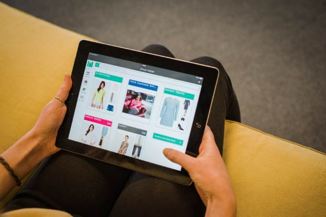 A shopper browses Mallzee's app on a tablet | Courtesy Mallzee
