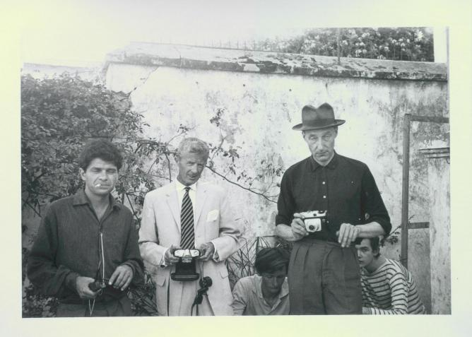 Gregory Corso, Paul Bowles, William Burroughs, Tangier (Michael Portman and Ian Summerville crouching behind Burroughs), 1961. ©Allen Ginsberg LLC, 2013/Flickr