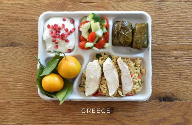 Baked chicken over orzo, stuffed grape leaves, tomato and cucumber salad, fresh oranges, and greek yogurt with pomegranate seeds