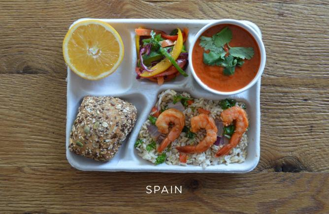 Sautéed shrimp over brown rice and vegetables, gazpacho, fresh peppers, bread and an orange