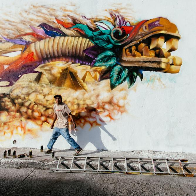 A grafitti artist works on a Quetzalcoatl, the benign prehispanic God that gave corn and fire to men © Hector Munoz, Mexico, Shortlist, Arts and Culture, Youth Award, 2015 Sony World Photography Awards