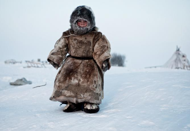 A Young Nenets boy plays in -40 degrees on Yamal in the Winter in Siberia. © Simon Morris, United Kingdom, Shortlist, People, Open Competition, 2015 Sony World Photography Awards
