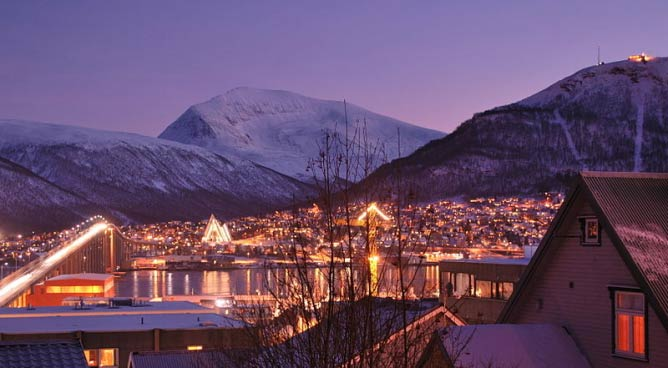 Early afternoon during the Polar Night, viewed from the upper reaches of Tromsø centre towards the mainland sid