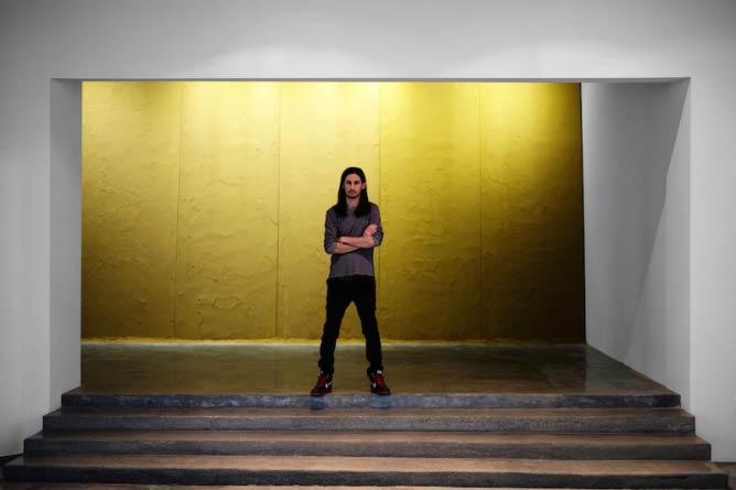 Kour Pour in front of his work at his Los Angeles solo exhibition at Depart Foundation | © Kour Pour