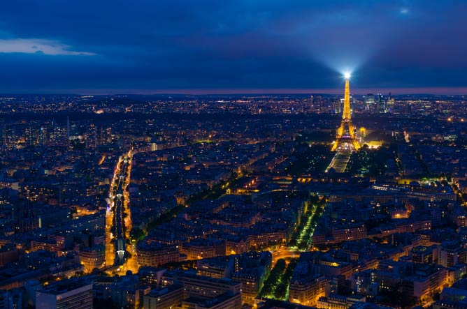 View of Eiffel Tower at night in Paris from the Montparnasse Tower