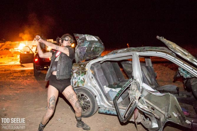 Punk girl ruins car © Tod Seelie