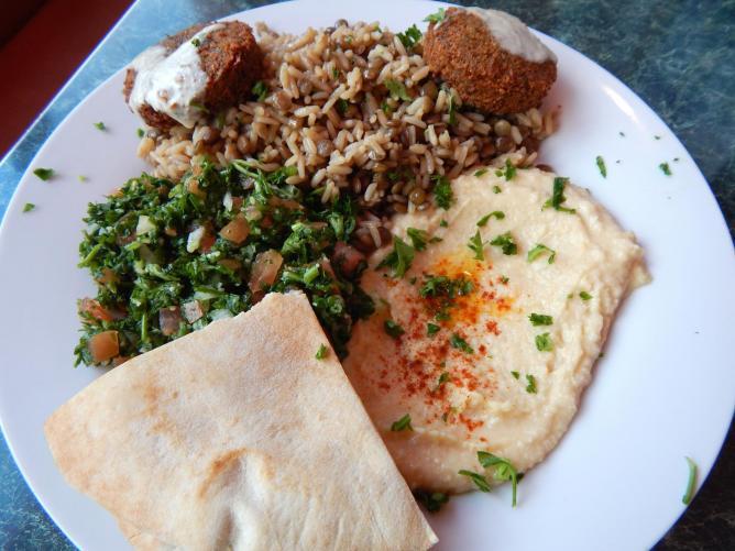 Med Cuisine's veggie platter with hummus, tabouleh, falafel, pita, and rice. Courtesy of Mediterranean Cuisine: