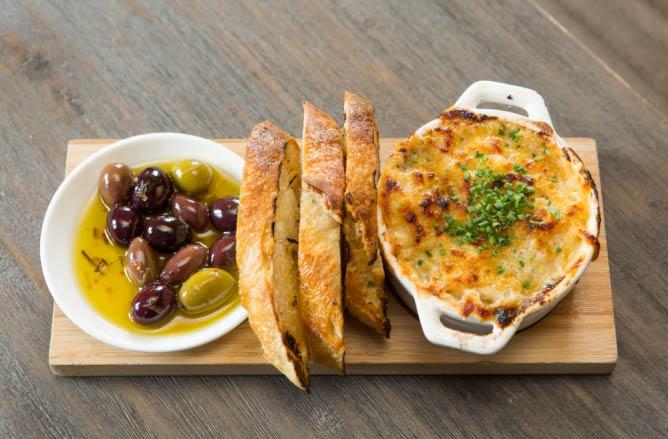 Wild mushroom fondue, grilled bread and house marinated olives | © Adam Larkey Photography