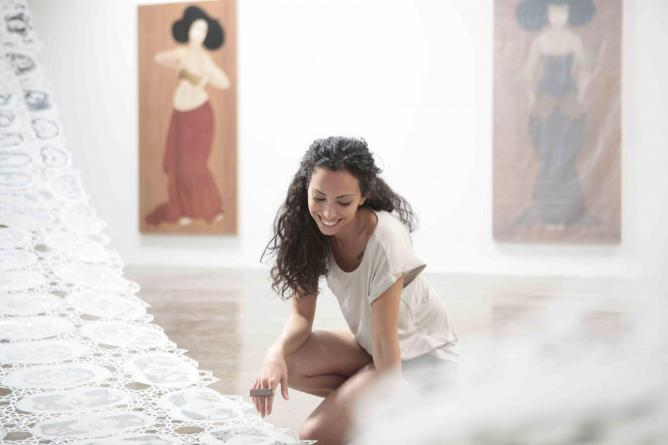US-based Iraqi painter and sculptor Hayv Kahraman, setting up her 2012 exhibition in Dubai courtesy of Barjeel Art Foundation, Sharjah, UAE