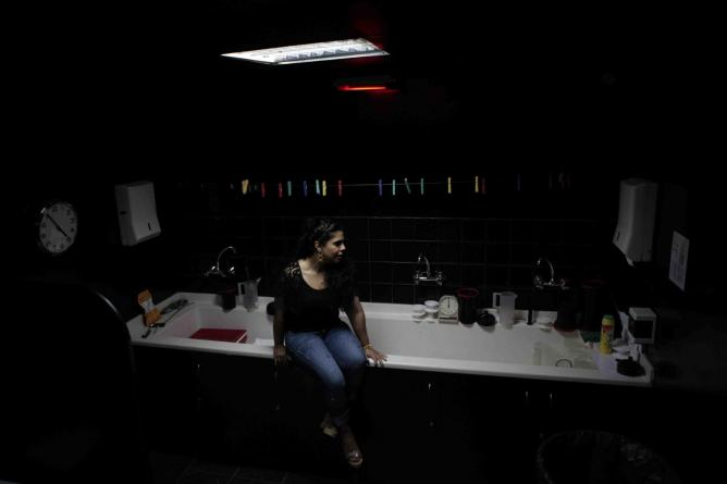 Saudi Arabian photographer and installation artist Manal Al Dowayan, in the Taksheel art centre's dark room in Dubai courtesy of Sueraya Shaheen