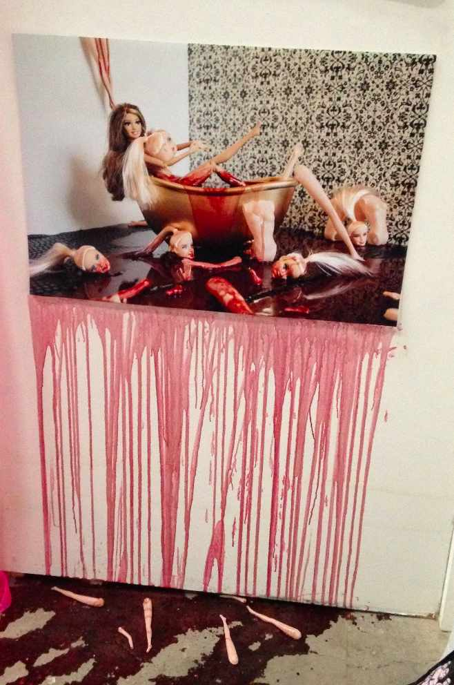 picture of mutilated Barbie dolls in a bath of blood