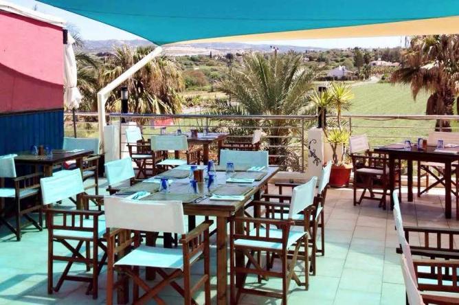 The beautiful outdoor dining area of Aqui Mediterranean Fusion Restaurant | Courtesy of Aqui Mediterranean Fusion Restaurant