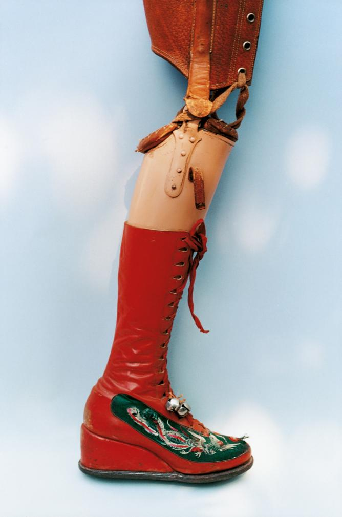 Red boot with prosthetic leg, belonging to Frida Kahlo
