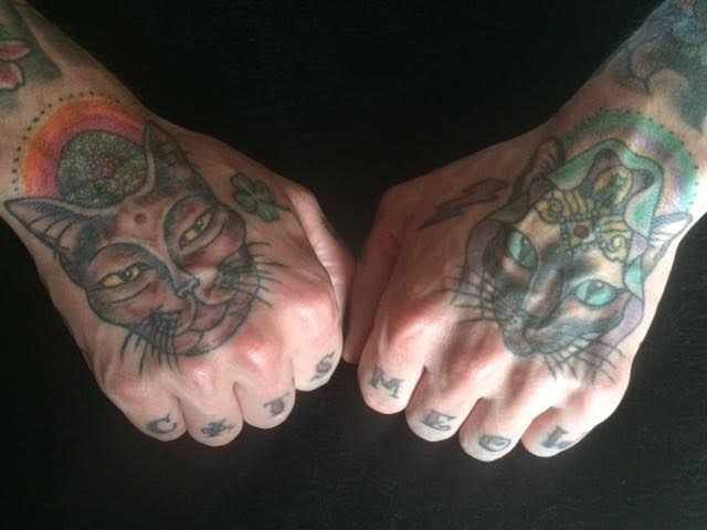 Tattoos. A Siamese version of the diety KuanYin and a Burmese Buddha | Photo Courtesy DQ