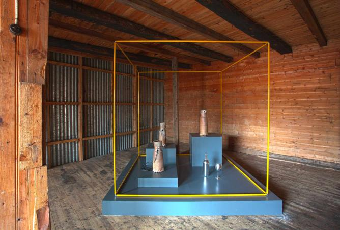 An unusual contemporary structure in the middle of a wooden room