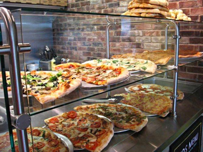 Pizza Counter | Courtesy of Luigi's A Slice Of Italy