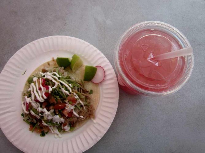 Carnitas taco and watermelon agua fresca