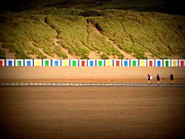 The colourful beach houses on Woolacombe beach