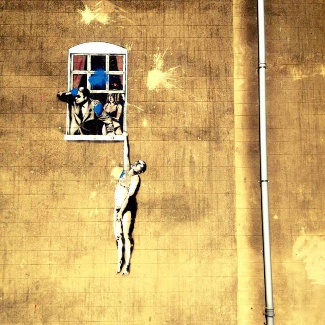 Banksy's 'Well Hung Lover' on Frogmore Street | Courtesy of Marianna Hunt