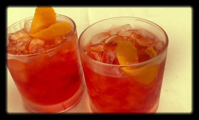 Two Stateside Boulevardier cocktails sit on the table at all-American inspired bar in Passyunk Square.