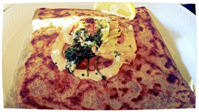 A crepe with shrimp, spinach, roasted leeks and seafood sauce looks appetizing at Crêperie Beau Monde.