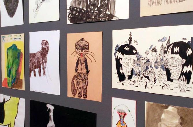A wall of drawings