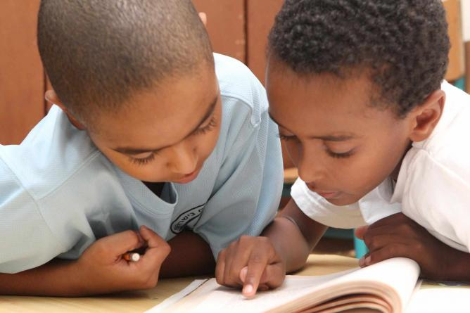Ethiopian immigrant children working on homework together at an afterschool program   © Courtesy Israel Tennis C