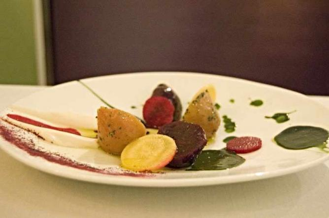 A plate of pickled beets with parsley root puree and beet powder at Schwa.