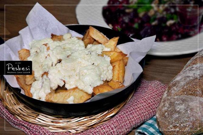 Cretan staka cheese on French fries   Courtesy of Peskesi