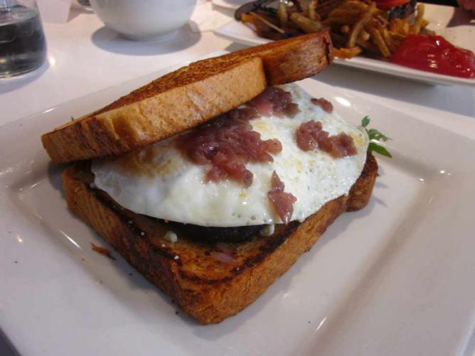 The sausage and egg sandwich on brioche with blue cheese and caramelized onions at Miles Table.