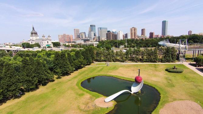 'Spoonbridge and Cherry' with view of Minneapolis