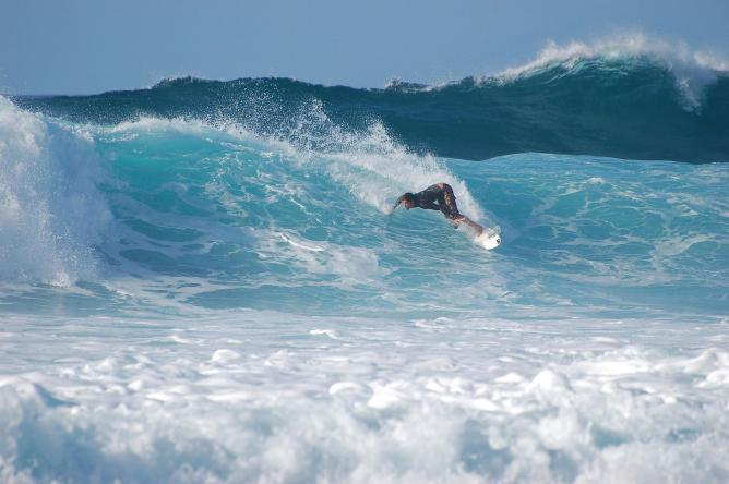 Surfer at Banzai Pipeline