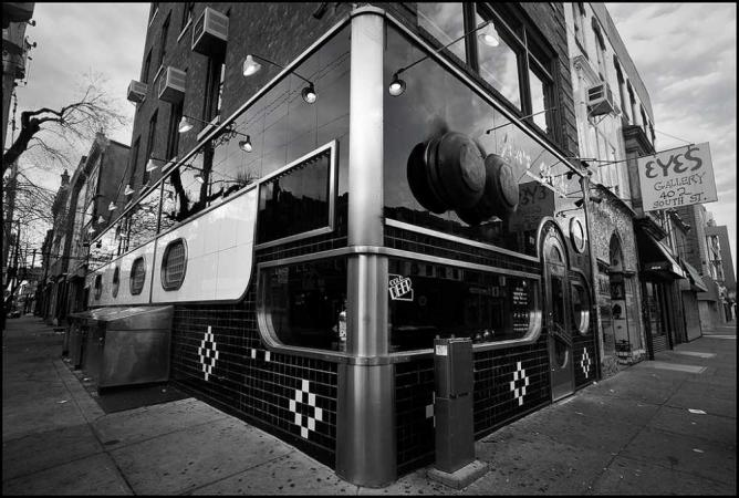 An outside of the facade of Jim's Steaks on South Street.