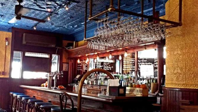 A shot of the beautiful French decor and bar area at The Good King Tavern.