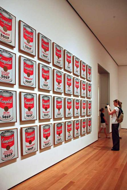 Warhol's Soup Cans, displayed in a grid, which MoMA has replaced by a line of paintings in the current exhibition.