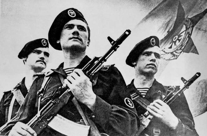 Three Soviet naval infantrymen carrying AK-74 assault rifles. Russian Hide-and-Seek is based on the premise that 21st century Britain is ruled by Russians |© US Dept. of Defence/Wikicommons