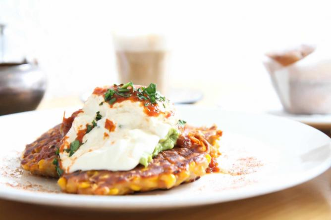 Corn Fritters, smashed avocado, house relish and sour cream | © The Parlor Milkbar and Kitchen