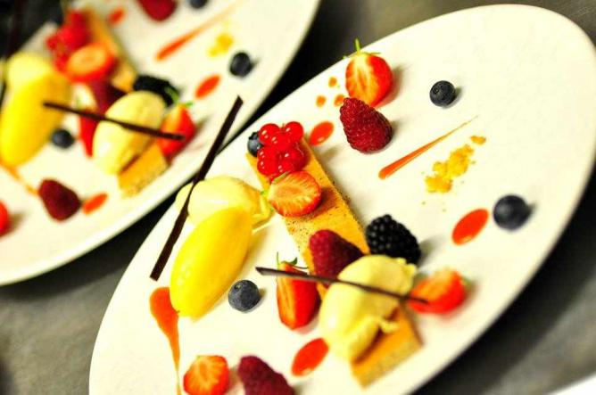 White chocolate and passion fruits mousse with red seasonal berries cake and strawberry ice cream | Courtesy of L'U.ni