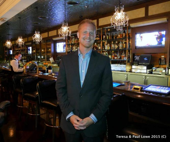 General Manager Case Cicchelli standing inside Triple George Grill.